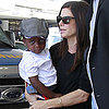 Sandra Bullock Holds Her Son Louis at LAX