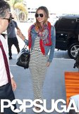 Miranda Kerr wore a scarf and denim jacket as she caught a flight out of LAX.