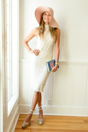 Laid-back Hamptons style looked good on Jessica Hart. The model picked a lightweight white dress for a Dolce & Gabbana lunch, finishing it off with a floppy hat, espadrilles, and a book clutch.