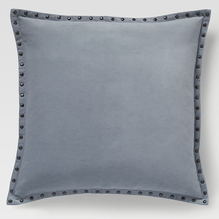 Velvet and studs? Say no more. This pillow cover ($39) in dusty blue has your name all over it.