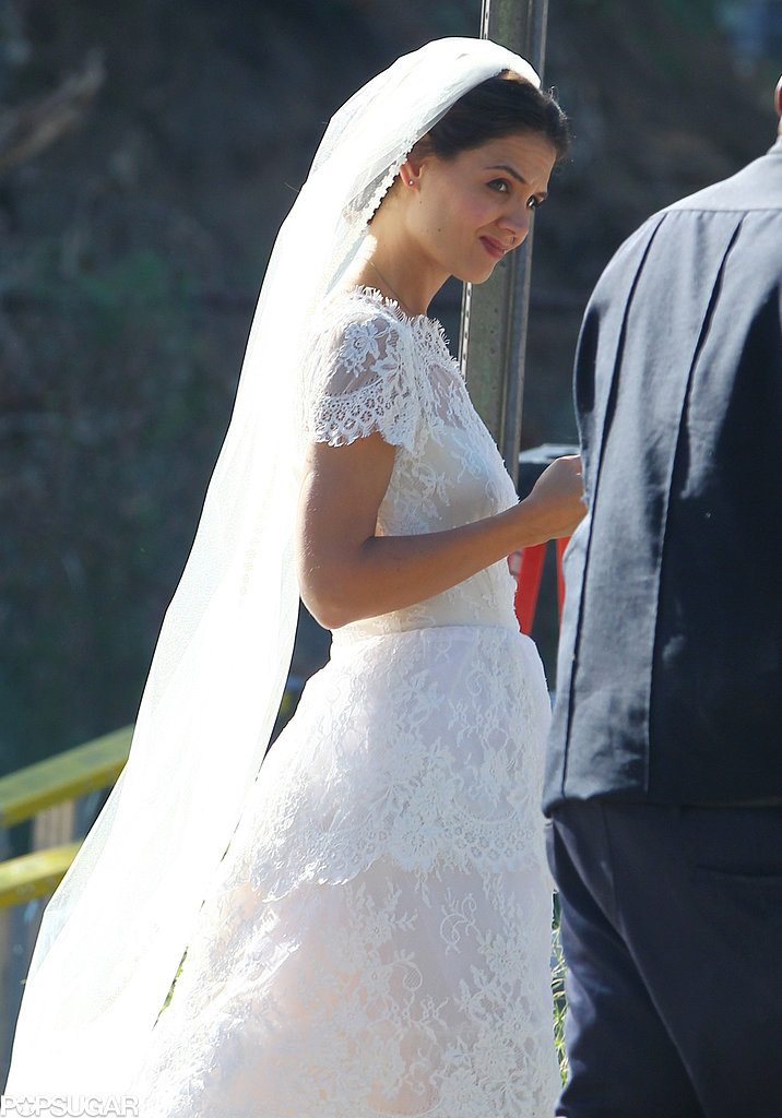 Katie Holmes donned a white lace wedding dress with a veil on set.