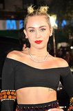 Miley Cyrus pulled her hair up into a double-topknot look with her signature cherry lipstick. Is it us, or are you getting a Gwen Stefani circa 1998 vibe here?
