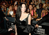 Lady Gaga smiles for the cameras on the VMAs red carpet.