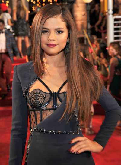 Matching burgundy lips and nails were the base of Selena Gomez's VMAs look. Her extralong, slightly lighter locks were styled superstraight for the show.