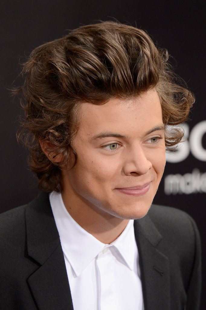 Harry Styles gave a sweet smirk while walking the red carpet.