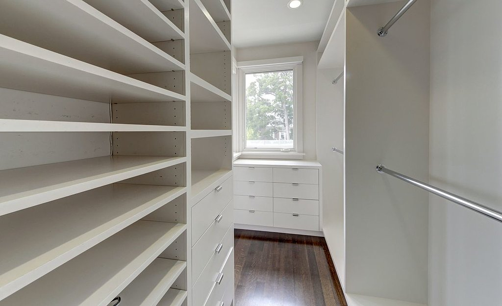 A walk-in closet proves to be just as bright and airy as the rest of the home.