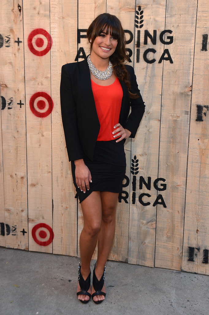 Lea Michele arrived at the FEED USA + Target launch event working a collarless black blazer, coordinating tulip skirt, and fiery tank. Strappy Louboutins and a statement necklace rounded up her Brooklyn look.