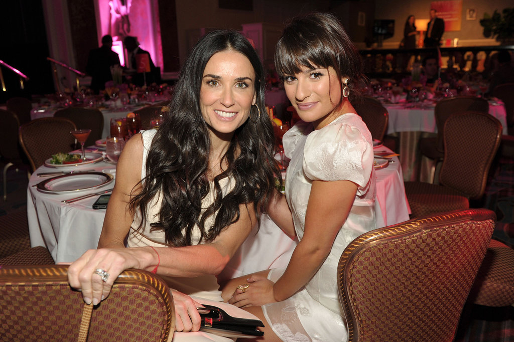 Lea Michele sat with Demi Moore during an LA event in September 2011.