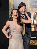 Lea Michele couldn't contain her laughter on the red carpet with her New Year's Eve costar Ashton Kutcher at the film's LA premiere in December 2011.