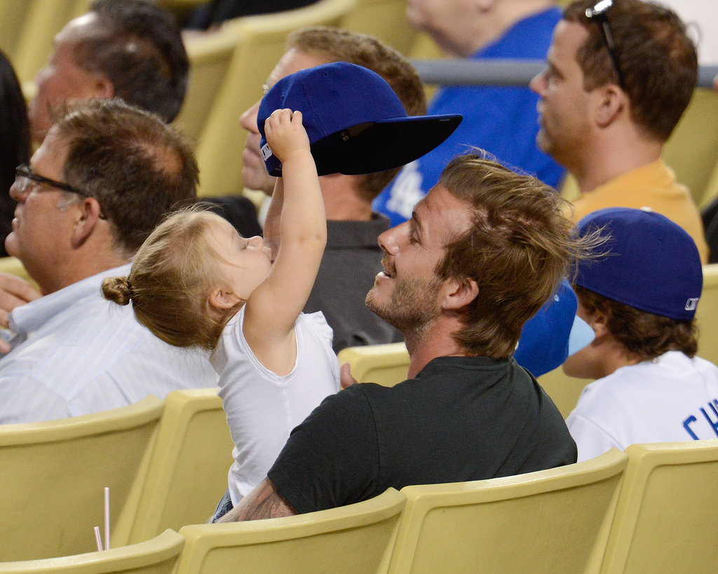 Harper Beckham played with her dad's Dodgers cap.