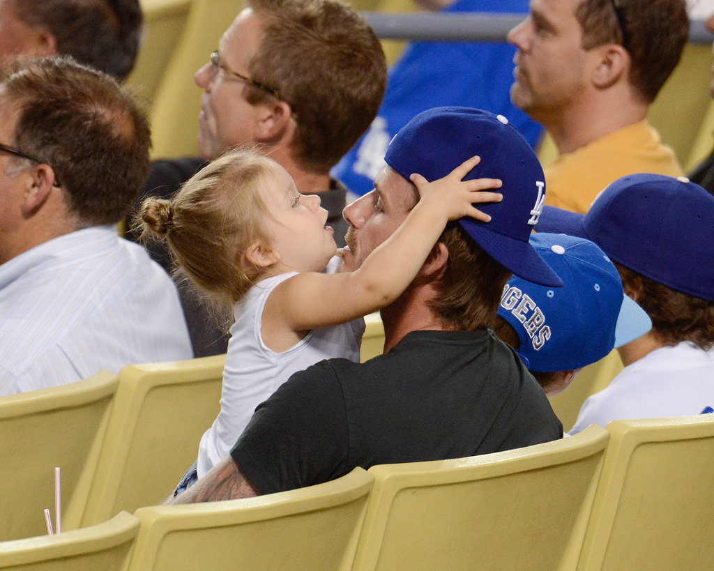 David Beckham and his daughter, Harper, cuddled during an LA Dodgers game.