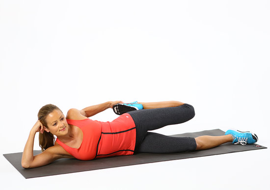 stretch it lying side quad stretch popsugar fitness