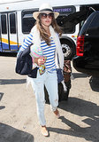 Alessandra Ambrosio was ready for her vacation in a nautical striped tee and panama hat as she arrived to LAX.