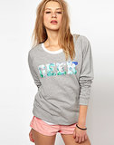 Say it in florals, wearing this bold geek sweatshirt ($51, originally $101).