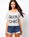 Add a little geeky glamour to your wardrobe, pairing this embellished crop top ($14, originally $37) with denim bottoms.