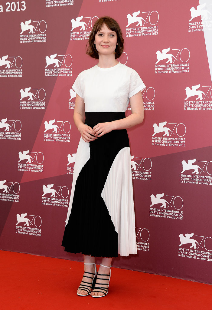 Mia Wasikowska got in on the black and white trend in a midi-length pleated Proenza Schouler dress and matching strappy sandals at the Tracks photocall at the Venice Film Festival.