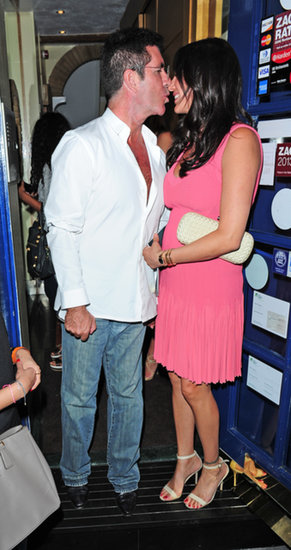 Simon Cowell and Lauren Silverman shared a kiss in London.