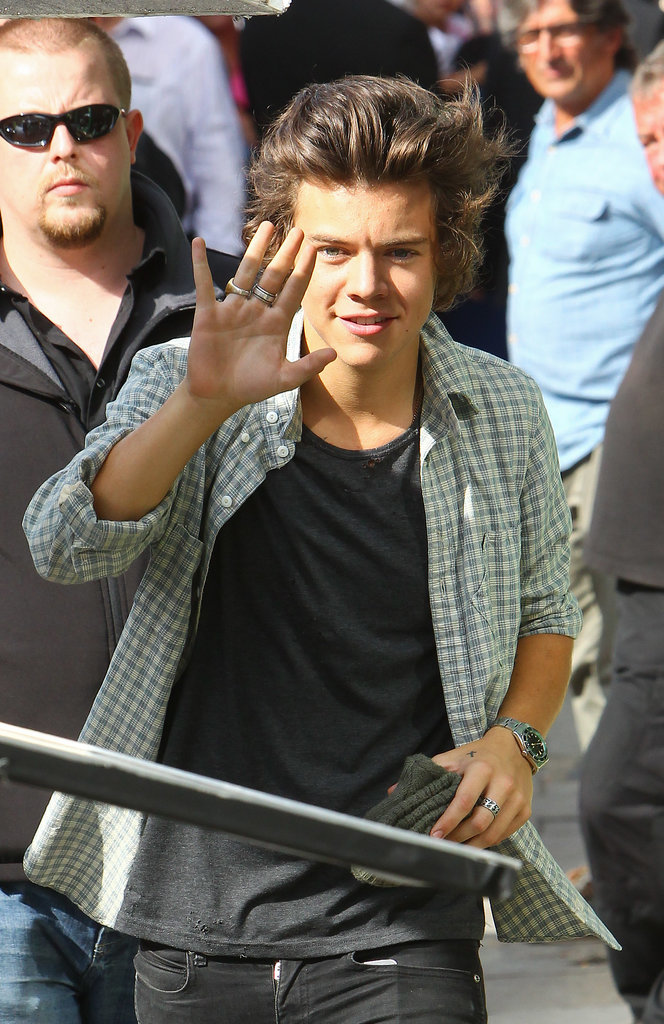 Harry Styles waved while filming a new One Direction video in London.