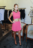 Nicole Richie attended a trunk show for Simone Camille looking sassy in a pink crop top and a matching pleated miniskirt, which she edged up with a chunky chain choker.