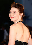 Actress Mia Wasikowska attended the Tracks premiere with her short hair pulled back and a bold red lipstick.