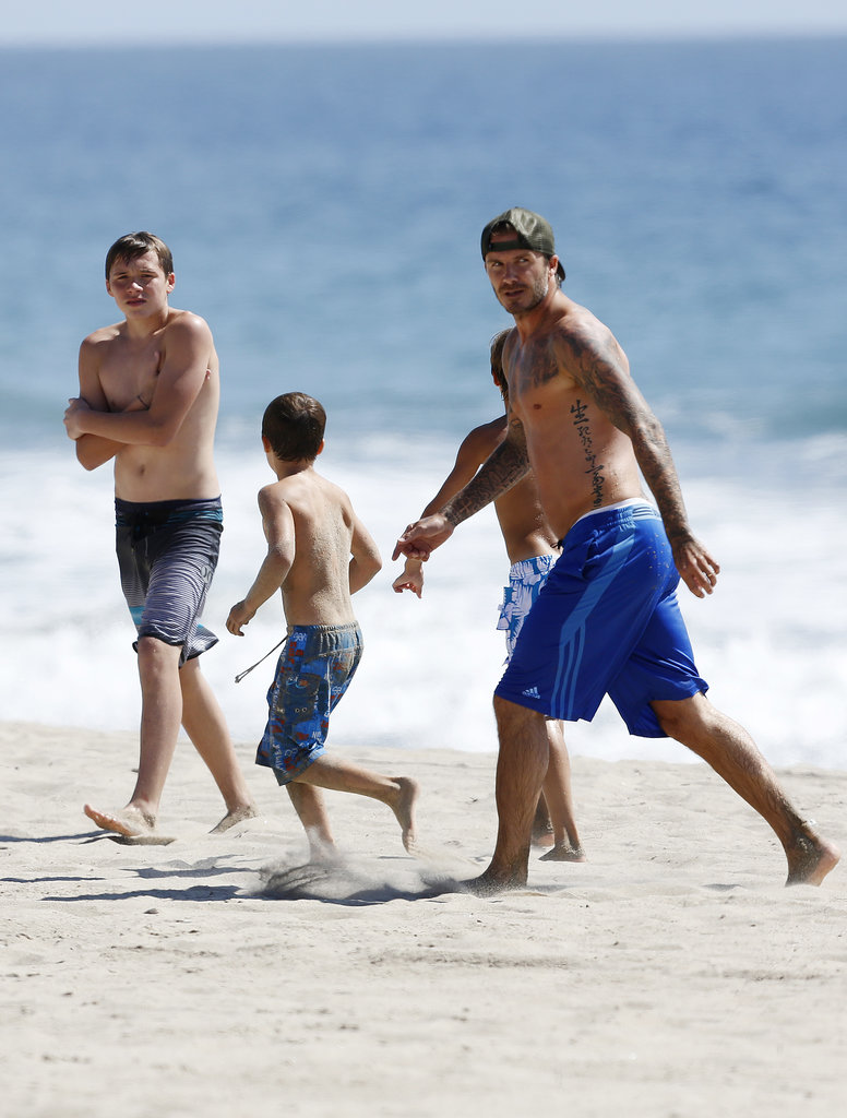 David Beckham and his sons went to the beach in Malibu in August 2013.