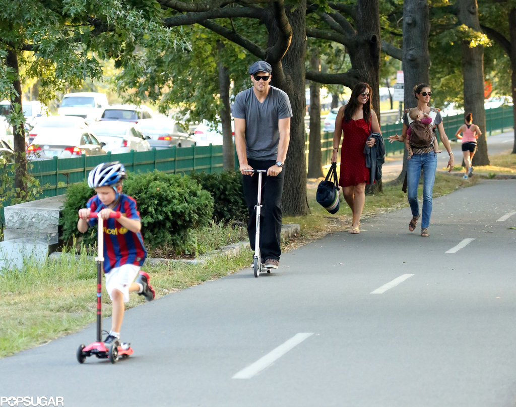 Tom Brady rode his scooter through a Boston park with Jack while Gisele Bündchen carried Benjamin and Vivian.
