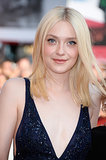 Later at the premiere of Night Moves, Dakota Fanning added a touch of shimmering navy eyeliner to complement her plunging gown.