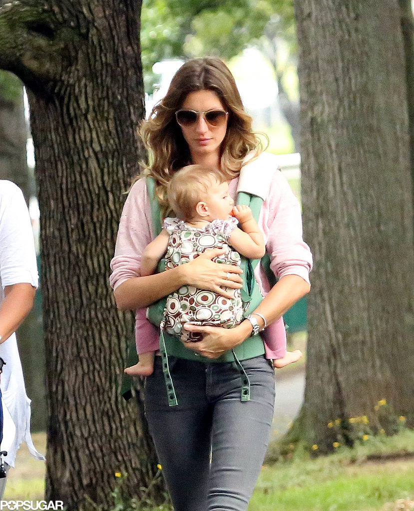 Gisele Bündchen carried her daughter, Vivian, through the park.