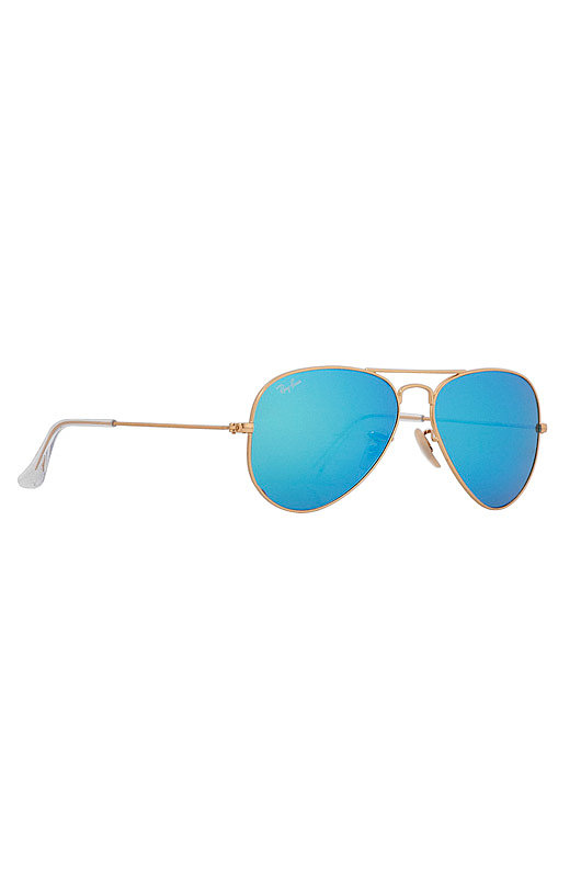 Sunglasses, $160, Ray Ban at Singer 22.