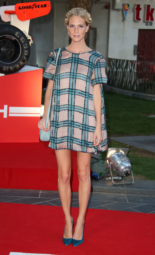 Poppy Delevingne worked the season's plaid trend in a retro shift on the red carpet for Rush.