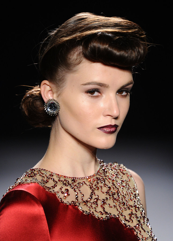 Rolled fringes and neat chignons were the order of the day at Jenny Packham's Autumn/Winter 2012 show.