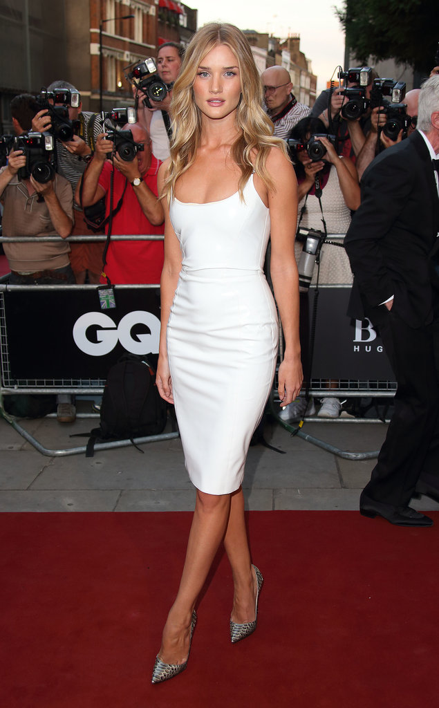 Rosie Huntington-Whiteley made the GQ Men of the Year Awards her catwalk in a slinky white Versace number.