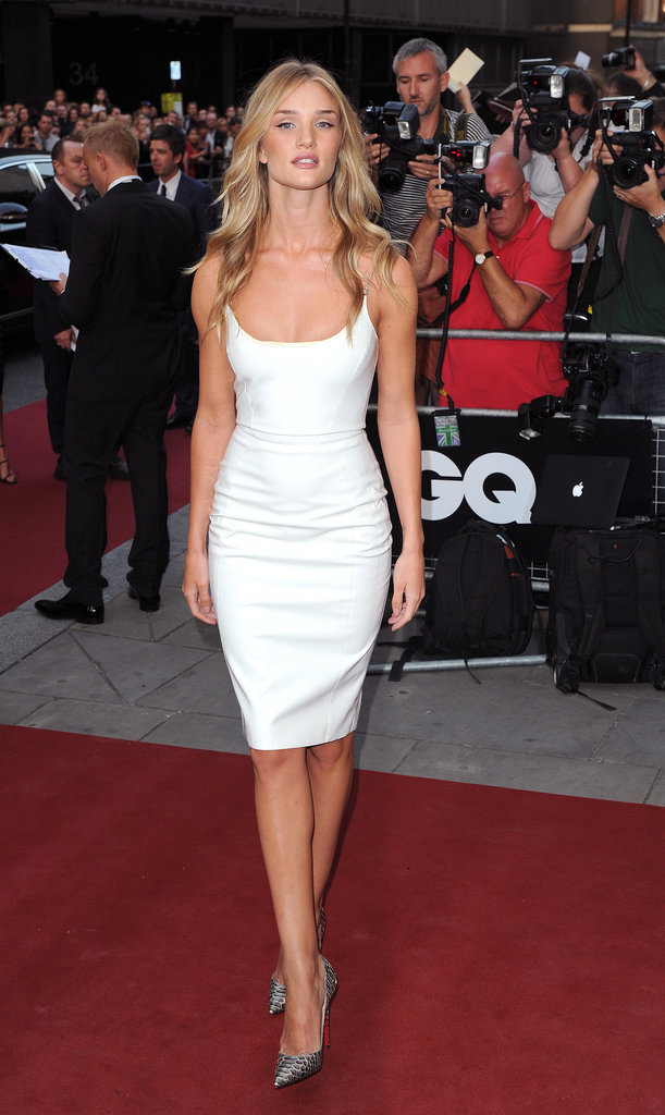Rosie Huntington-Whiteley stunned in a white Versace dress at the GQ Men of the Year Awards in London. She added a pair of python pumps for a luxurious finish.