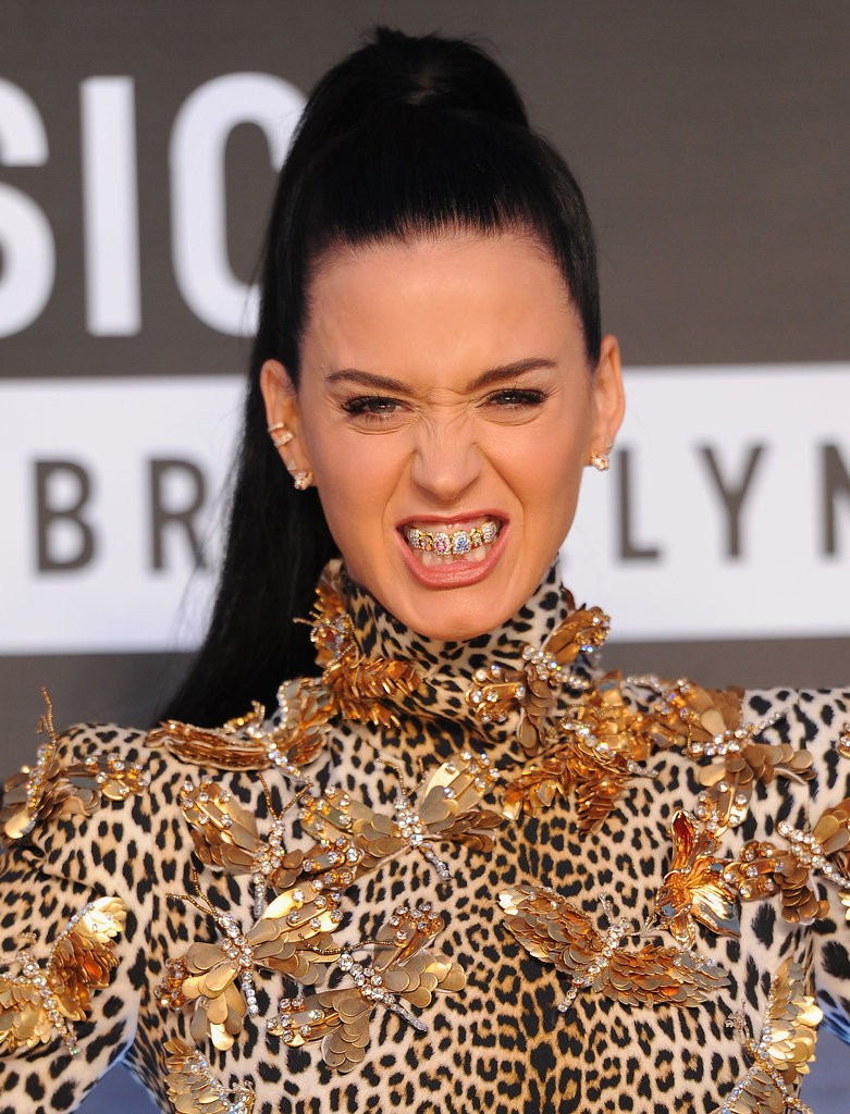 Katy Perry wore a flashy grill to the VMAs this year.