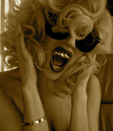 Lady Gaga shared a photo of her gold grill back in 2010. Source: Twitter user ladygaga
