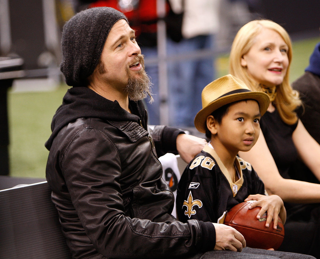 Brad Pitt and his son Maddox Jolie-Pitt took a seat on the bench before  New Orleans Saints playoff game in January 2010.