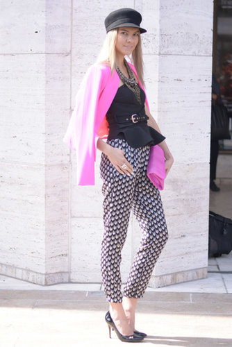 As if we wouldn't notice her printed pants and bright pink topper.