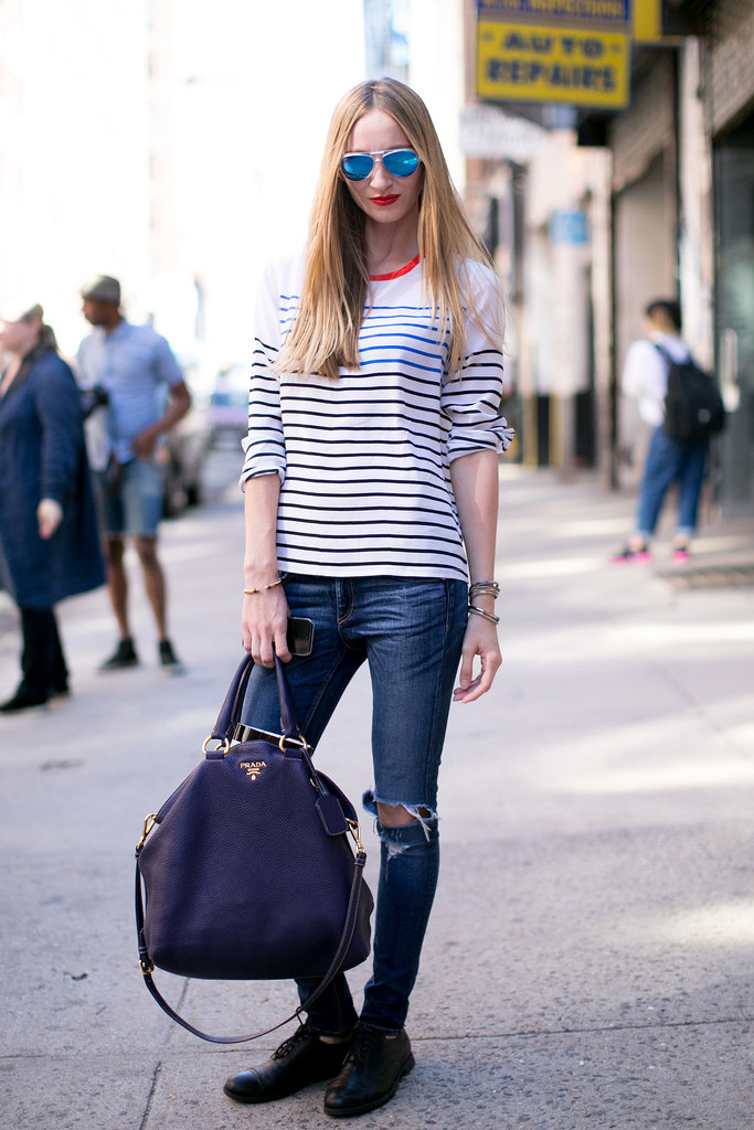 Taking a page out of the model-off-duty style book, all you need is great shades, cool denim, and a luxe bag.