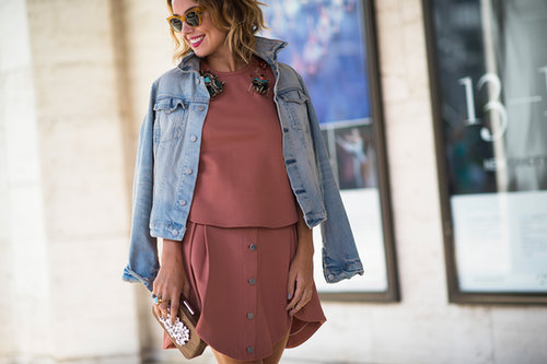 Kelly Framel played it cool in denim and an easy day dress outside the tents, but made her accessories count with a Devi Kroell clutch and Phillips House Meridian rings.
