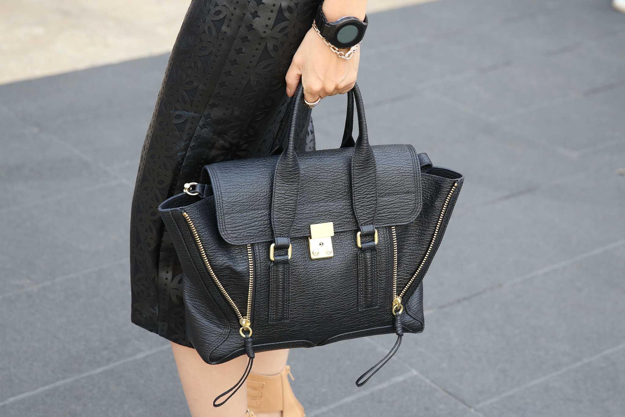 A sleek 3.1 Phillip Lim Pashli spotted outside the tents.