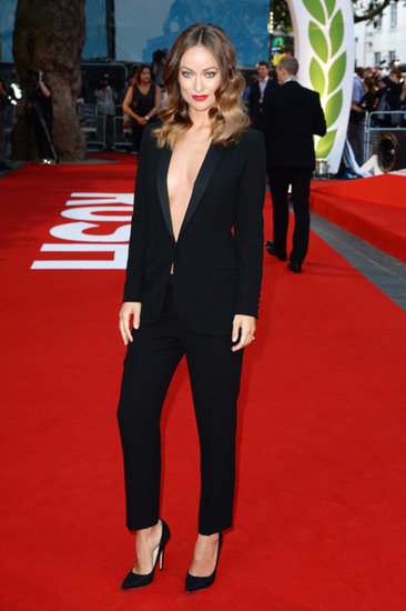 Olivia Wilde took a deep plunge into her one-of-a-kind black Gucci tuxedo at the Rush premiere in London. Black pumps, loose waves, and red lips proved to be the gorgeous finishes.
