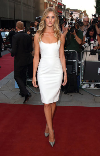 A little white Versace dress is all Rosie Huntington-Whiteley needed to  stand out at the GQ Men of the Year Awards. Python pumps added a hint of the wild.