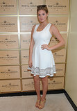 Kate Upton sported a sweet white dress while hanging in the Moet & Chandon suite.
