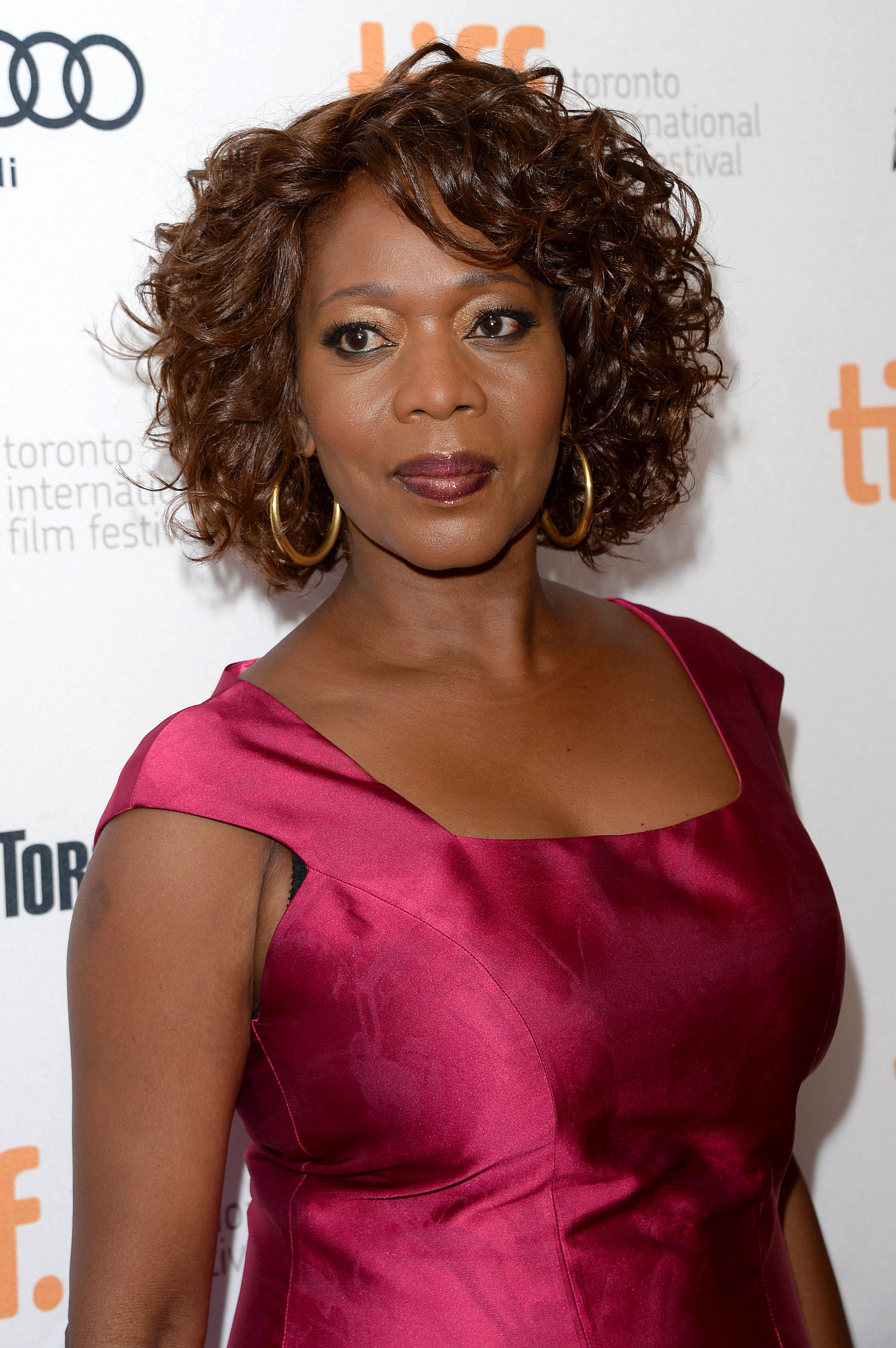 Alfre Woodard's garnet-hued lipstick perfectly matched her jewel-toned dress on the 12