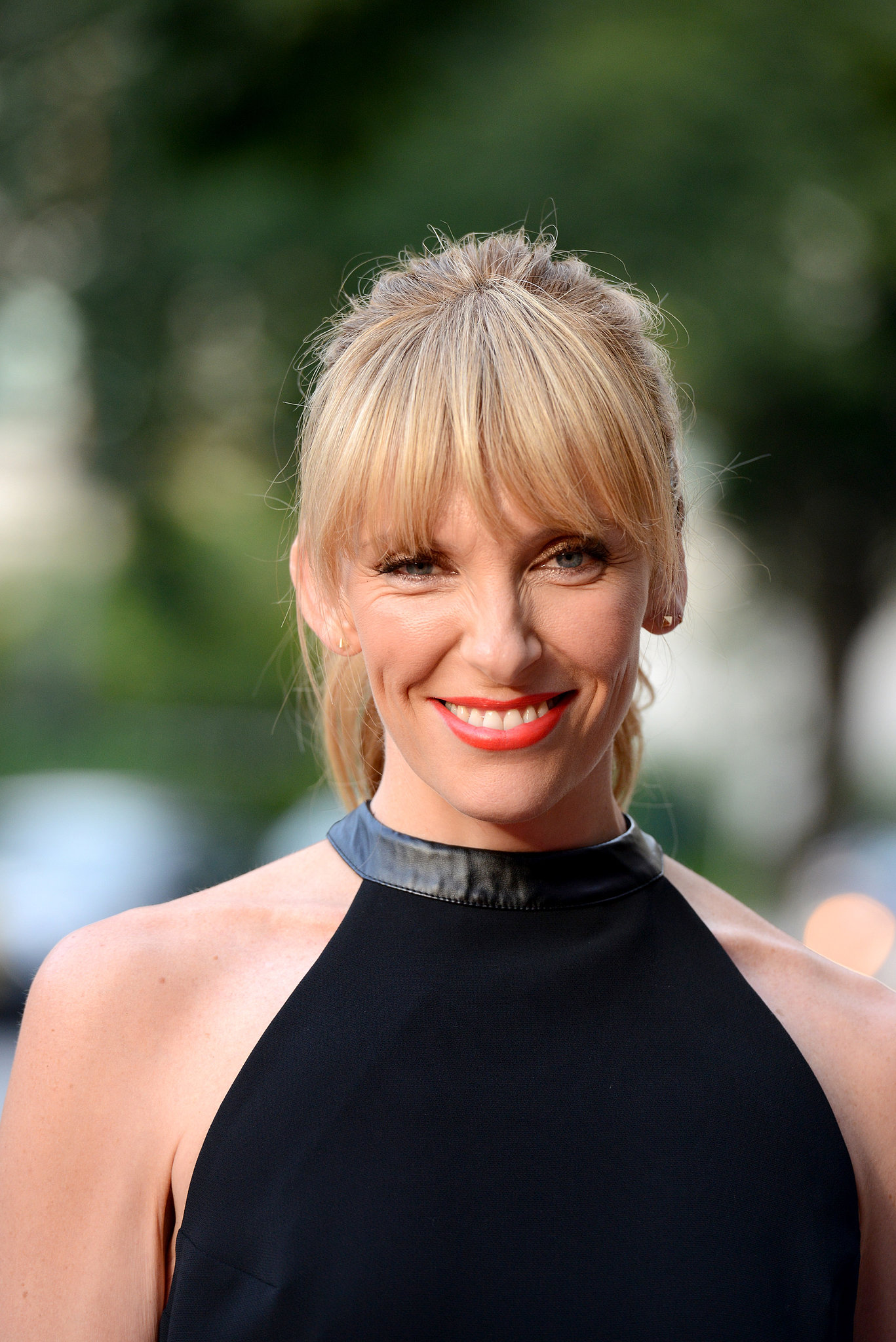 Toni Collette dazzled in a red-orange lip while attending the Lucky Them premiere at TIFF.