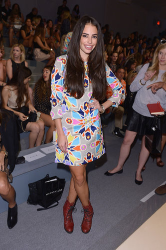 Chloe Bridges paired a bright, geometric shift dress with lace-up boots in the front row at Mara Hoffman.