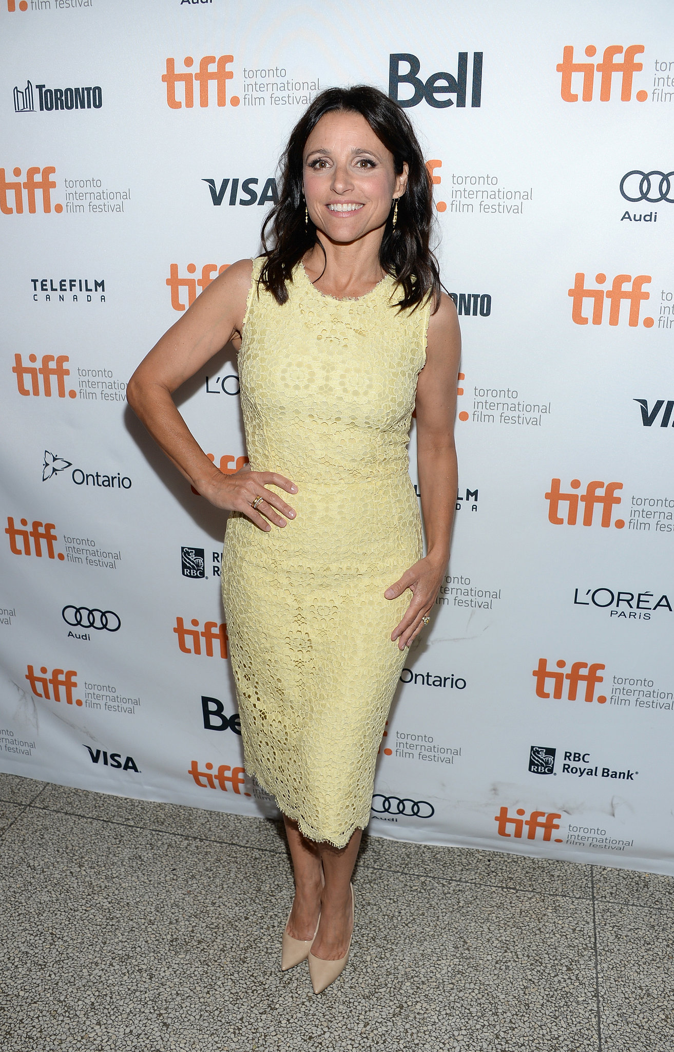 Julia Louis-Dreyfus wore a pale yellow dress at the Enough Said premiere.