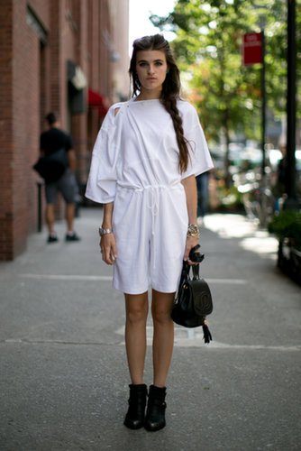A little white dress — and a little Chanel bag in tow.