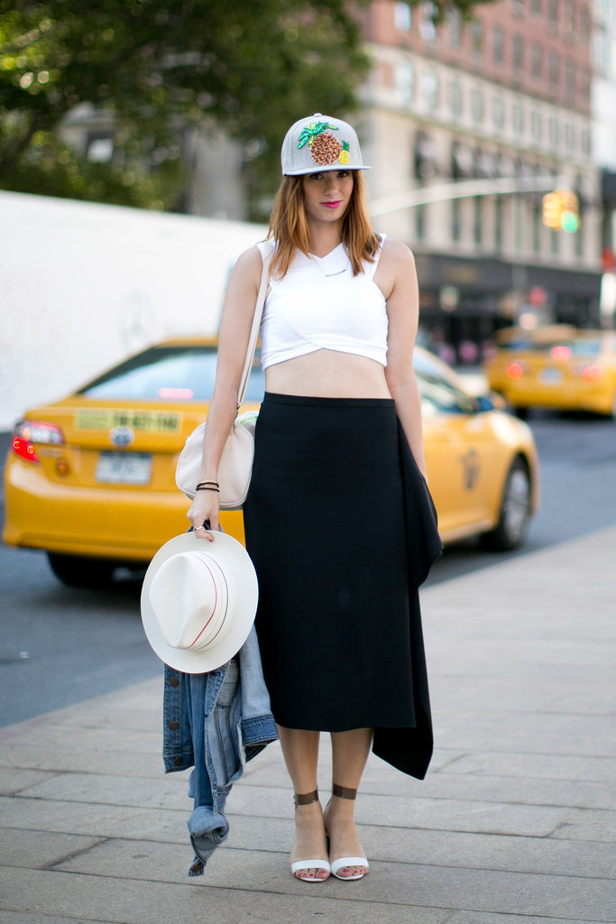 We can't decide if we love her crop top or quirky cap more.