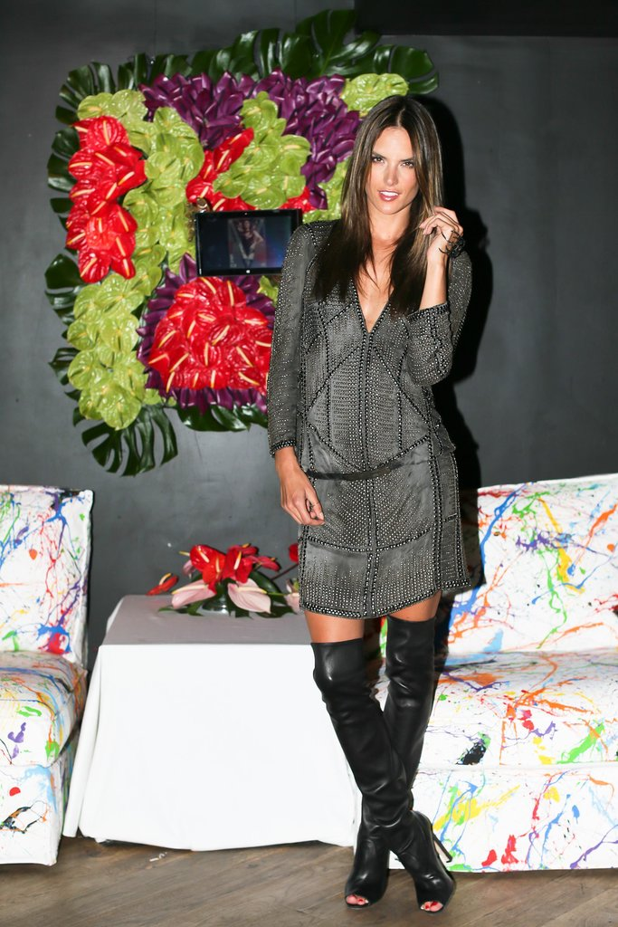 Alessandra Ambrosio paired a gray dress with peep-toe over-the-knee leather boots at the Stephen Gan & V Magazine party.